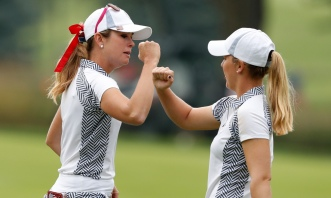 United States' Paula Creamer, left, celebrates with teammate Austin Ernst after making a putt on the fifth green during her foursomes match in the Solheim Cup golf tournament, Saturday, Aug. 19, 2017, in West Des Moines, Iowa. (AP Photo/Charlie Neibergall) ORG XMIT: IACN110